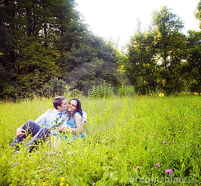 Free Kiss Of Romantic Lovers In The Green Grass Stock Photo - 12526920