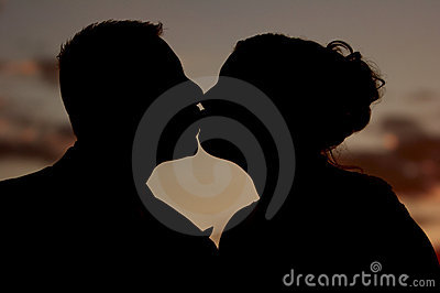 The kiss at sunset (silhouette)