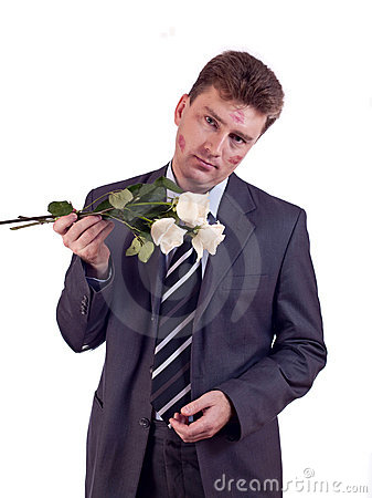 Kissed man with white roses