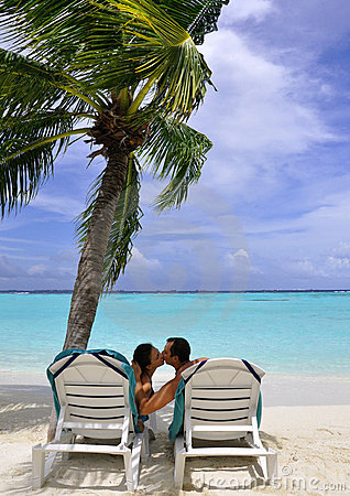 Kissing couple on beach