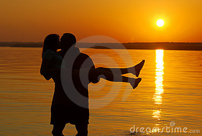 Kissing couple on the beach
