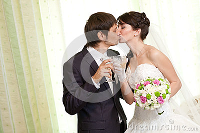 Kissing couple with champagne