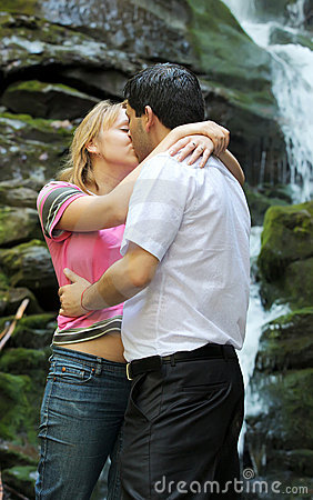 Kissing couple in mountain