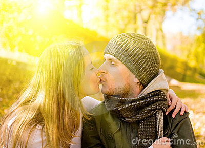 Kissing couple in park