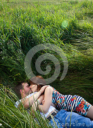 Kissing in grass