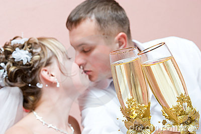 Kissing Newly-married couple with champagne