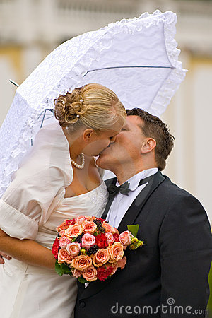 Kissing newlyweds