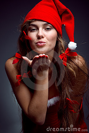 Kissing santa helper girl
