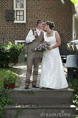 Kissing wedding couple