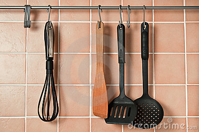 The kitchen accessories hanging on hooks