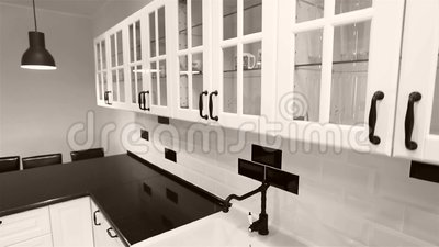 Kitchen cabinets, video crane used. Black and white modern kitchen furniture, seen from above. Real estate agency