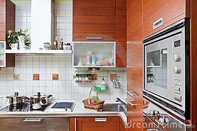 Kitchen interior with build in microwave oven