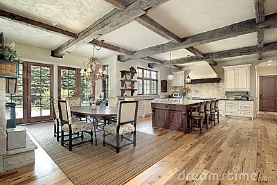 Kitchen With Island And Ceiling Wood Beams Royalty Free