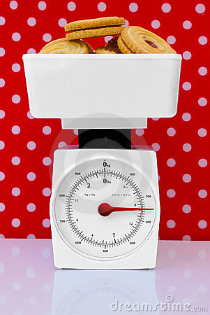 Kitchen scales with cookies diet concept