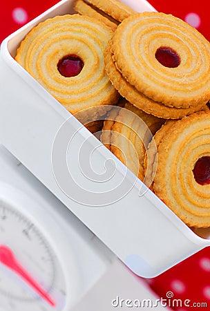 Kitchen scales with jam cookies diet concept