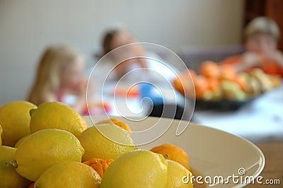 Kitchen scene with lemons and children