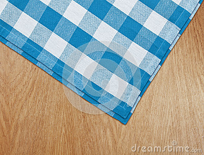 Kitchen table with blue gingham tablecloth