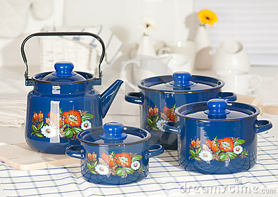 Kitchen utensil set of blue pots and kettle