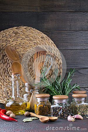 Free Kitchen Utensils, Herbs, Colorful Dry Spices In Glass Jars Stock Photo - 112338180