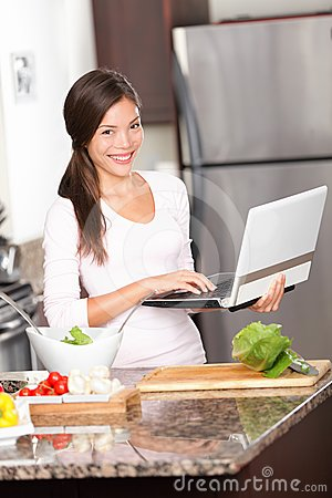 Kitchen woman on laptop