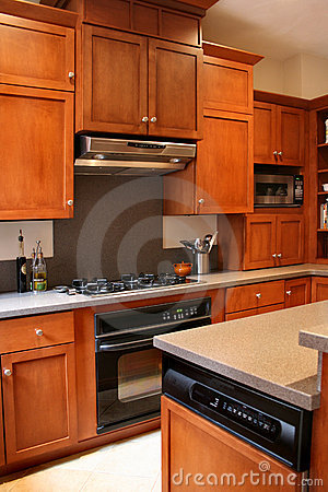 Kitchen wood cabinets black and stainless stove