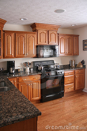File:Newly renovated kitchen with cabinets refrigerator stove and ...