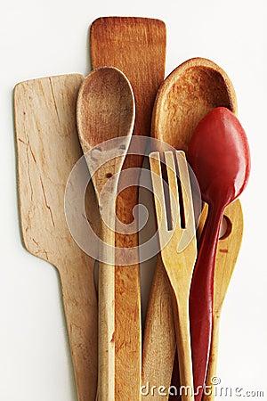 Kitchen wooden utensils on a white background