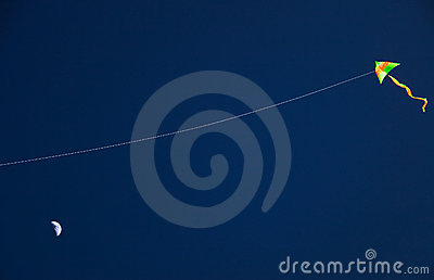 Kite on dark sky background