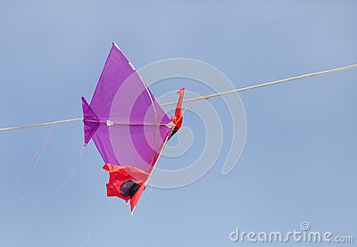 A kite hanging from a wire