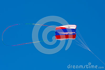 Kite shaped like handbag against blue sky