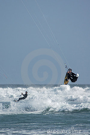 Kite Surfers Riding and Jumping
