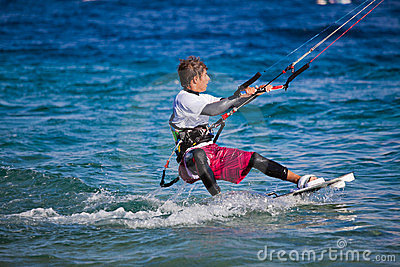 Kite surfing on the sea.