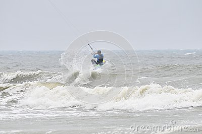 Kite-surfing in spray.