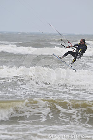 Kite surfing in spray.