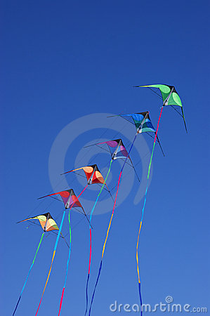 Kites against blue sky