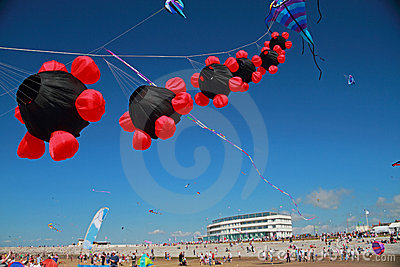 Kites flying in clear blue sky