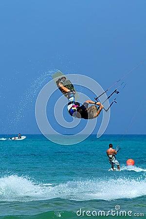 Kitesurfer making extreme trick Editorial Photo