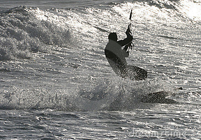 Kitesurfing on sparkling sea