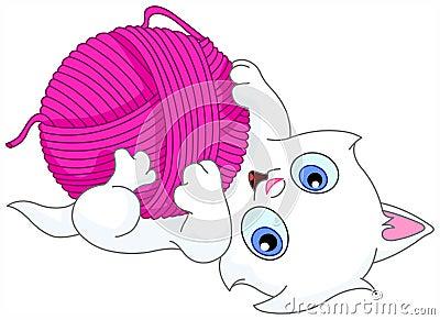 Kitten with wool ball