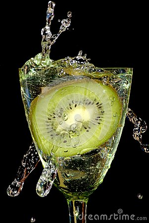 Kiwi in sparks of water