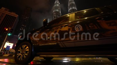 KL, MALAYSIA Nov 13, 2019: The Petronas Towers from a pedestrian crossroads. KL, MALAYSIA Nov 13, 2019: View of the Petronas Towers from a pedestrian crossroads stock video footage