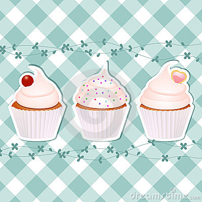 Kleine Kuchen auf blauem Gingham