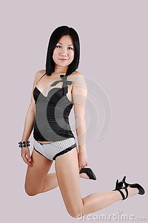 Kneeling girl in lingerie.