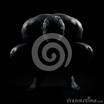 A kneeling man