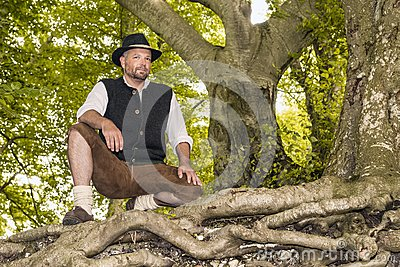Kneeling man in traditional Bavarian costumes
