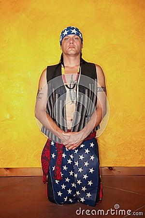 Kneeling Native American man