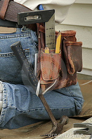 Free Kneeling Worker And Tool Belt Stock Photography - 292152