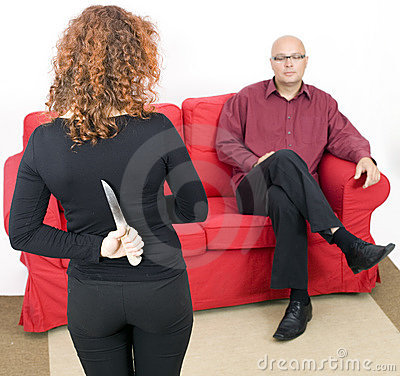 From knife for backs woman, man in background