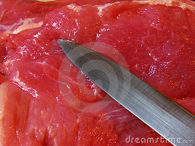 Knife blade on meat