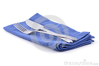 Knife and fork on blue napkin